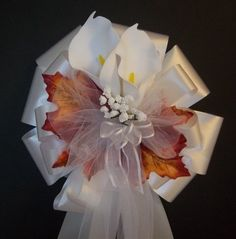 This listing is for 6 white calla lily fall pew bows.  Arrive Full and Fluffed ready to use!    These pretty bows are currently available from Ecrater.com seller CSIS Bridal Boutique.