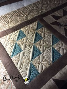 Gotta love feathers combined with ruler work. Quilt made by Anne Goodwin and quilting by Kelly Corfe www.thequiltbee.com…