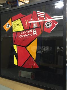 The FrameMaker team have been working very hard on this signed Steven Gerrard shirt montage. Made up of all the iconic trophy winning seasons shirts with a black acrylic backdrop including images and text which is back lit by LED lighting!