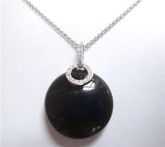Black Agate & Diamond Pendant - One beautiful black agate stone and 0.05ct of diamond make up this pendant. K506048 (subject to prior sale) – Lilliane's Jewelry – 4101 W. 83rd St. Prairie Village, KS 66208 – 913-383-3376 –
