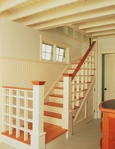 Basement ceiling idea: put up bead board between floor joists and paint it. White to brighten the space