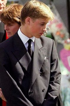 Prince William stands outside Westminster Abbey at the funeral of his mother Diana, Princess of Wales on September 6, 1997 in London, England