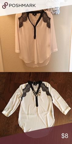 Sheer black and white blouse Nice sheer white blouse with black lace. Worn once. Great condition. 100% polyester. Size small but fits like a medium. Iz Byer Tops Blouses