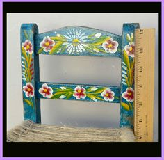 This blue, hand painted chair is a great example of Mexican, tourist folk art from the 1950s. Small size. Hand painted and in fabulous condition.It is