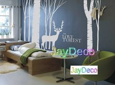 New Vinyl Tree Wall Decals Tree Removable Wall Stickers Decal Home Decor Deer Tall Tree Forest - 53 inches (H) x 79 inches (W). $45.99, via Etsy.
