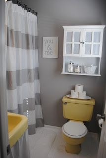 I like the grey and yellow...cute bathroom makeover...