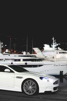 Aston Martin with nice yacht behind it. Bugatti, Lamborghini, Jaguar, Mustang, Small Luxury Cars, Aston Martin Dbs, Latest Cars, Bmw, Cool Stuff