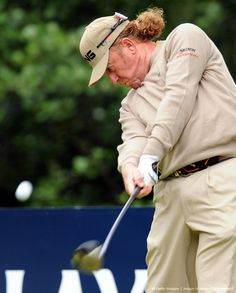 Miguel Angel Jimenez of Spain hits his t