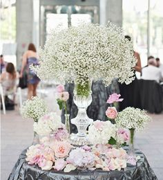 Beautiful baby's breath centerpieces are great value for money and looks pretty.  Mix your baby's breath with edgy accessories to match your wedding theme. Check it now!