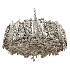 Designers often say that chandeliers are the jewelry in the room's decor   ...in this instance it is so true...the chandelier resembles a diamond bracelet