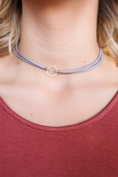 Play It Cool like you don't know that everyone's eyes are on you, but that just comes with the territory of wearing such a stylish necklace! It is a faux suede, double strand choker with high polish g