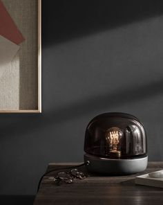 Norm Architect's Stone lamp (above) embodies the intangible Danish concept of 'hygge', with its ceramic base supporting a mouth-blown glass shade that revealing the bulb and emits a glow akin to candlelight