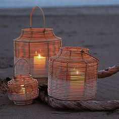 Bring a natural element – and a bit of mood lighting – to any table. Woven by hand of natural rattan, then detailed to look as though the bottom half was dipped in white paint. A glass hurricane sleeve adds protection from drafts and dripping wax. Rattan, Candle Lanterns, Coastal Living, Outdoor Entertaining, Exterior Design, House Design, Lights, Outdoor Decor, Outdoor Life