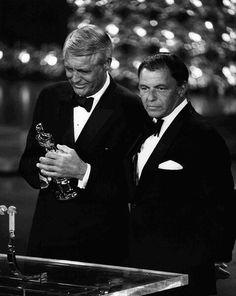 Frank Sinatra awarding Cary Grant with an Honorary Academy Award, 1970.