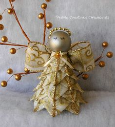 A beautiful angel made from a beautiful ribbon of metallic gold swirls on cream. This angel can be hung as an ornament or she will stand on her own. She will be a beautiful addition to your Christmas decor or as a gift to hang on a bedpost, cabinet knob or sitting on a shelf watching over you. All my ornaments are my own original designs and made individually with great care to detail.