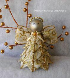 A beautiful angel made from a beautiful ribbon of metallic gold swirls on cream.