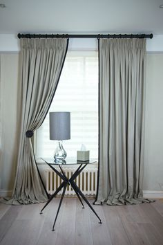 Kildare Limestone Curtains with King Pleat heading, leading edge boarder in Kildare black with jumbo piping Prêt à Vivre | Design Ideas