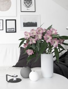 Living room details. Cooee vases, Lyngby vase and Normann Copenhagen Nocto candle holder