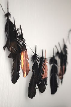 feathers. garland. black. gold