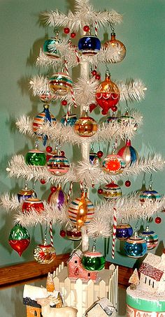 Vintage white Christmas tree (love the ornaments too!) Maybe someday, my little Prince Boo kitty will grow out of bothering my Christmas tree. LOL