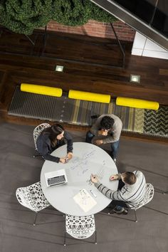 Circular collaboration space, suited to getting ideas down (write on the furniture!)