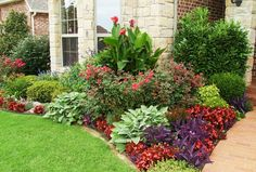 """""""unique by design""""... ? like the brick border and cluster of color. throw in some orange lillies and we have a deal."""