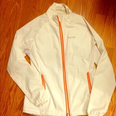 Marmot jacket White lightweight jacket.  Perfect for running.  Thumb holes, zipper pockets and a cord to cinch at waist.  White and orange.  In great condition Marmot Jackets & Coats