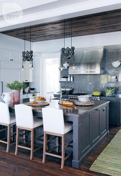 Rustic Cottage Kitchen. Kitchen The kitchen has an open-concept style with white dishware.