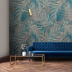 Create a tropical feature wall with our Palm Fever Wallpaper. This mural wallpaper has it all! Large, elegant palm leaves line your wall. The teal base colour matches perfectly with dark shades of wood. Kitchen Feature Wall, Feature Wall Design, Feature Wall Bedroom, Bedroom Wall, Blue Feature Wall Living Room, Funky Living Rooms, Living Room Colors, Teal Wallpaper Feature Wall, Teal Wallpaper Living Room