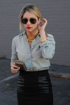 leather skirt and denim shirt! i love it! (Horizontal lines of the pockets help define her hip area)