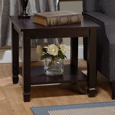 Tie your room together with this gorgeous espresso end table. Classically designed in the mission style, this end table has a rich, dark finish that will work well with casual, traditional, transitional, and country decorating themes.