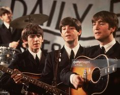A group shot of the Beatles, Ringo Starr (in the background), George Harrison (1943 - 2001), Paul McCartney and John Lennon (1940 - 1980), pictured during a performance on Granada TV's Late Scene Extra television show filmed in Manchester, England on November 25, 1963.