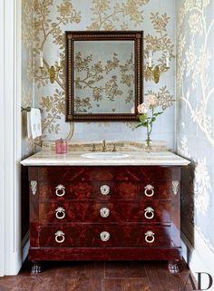 Gracie wallpaper lines a powder room | archdigest.com