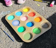"""Outdoor Homemade """"Paint"""": Place 2 tablespoons corn starch into one cup of the muffin tin. Pour 2 tablespoons water on top of the corn starch. Add 4 drops food coloring (any color) to the muffin tin. Stir well. Repeat for each color that you'd like to make (note: teach mixing colors by making purple with blue and red, etc.) Using a foam brush, go outside and paint on the driveway or sidewalk."""