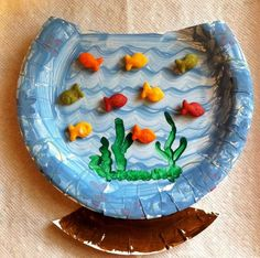 A paper plate fishbowl craft with goldfish crackers, which is great to use…