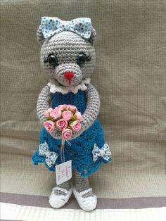 Madame ours et son bouquet de rose