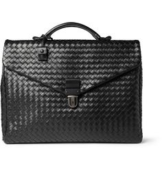 The craftsmen responsible for hand-weaving this Bottega Veneta briefcase studied for at least three years to gain their artisanal status in the renowned intrecciato technique on fully display in this briefcase. Marrying practical needs with timeless quality, this lustrous leather piece is softly structured yet will support the weight of a laptop or tablet with ease.