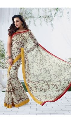 Grace yourself by draping in this Off White #chiffon #brasso printed #casual wear #saree with trendy and #elegant print on it. The saree is an ideal choice of attire for casual events and comes attached with matching blouse piece that can be custom made for upto bust size of 42 inches.