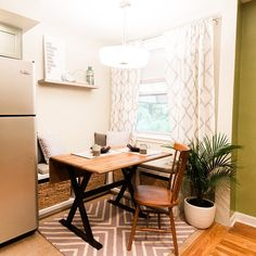 A comfortable breakfast nook with a stained wooden kitchen table, a storage bench with seat cushions and throw pillows, a spindle-back chair, and a gray and white area rug with a chevron pattern. Stools For Kitchen Island, White Kitchen Island, White Kitchen Backsplash, Kitchen Rug, Painted Granite Countertops, White Kitchen Table Set, Built In Bench, Bench Seat, Paint For Kitchen Walls