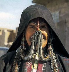 "Bedouin woman from the Negev Desert | Under her coin-covered face veil, she is also wearing a nose ring || ©Shelagh Weir ""Palestine Costume""  British Museum Publications, London.  1989.  Page 190"