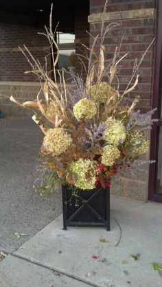 Fall container with landscape around yard