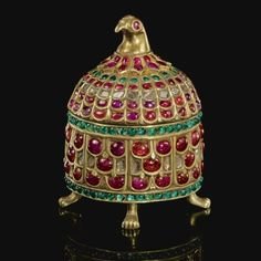 An Indian Gem-Set Gilt-Metal Casket with bird-head finial, India,  19th Century.  Photo Sotheby's