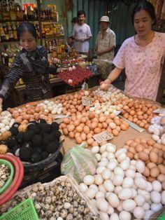 selling eggs at the Binh Tay Market, Ho Chi Minh City (Saigon), Vietnam. Photo: Christian Kober