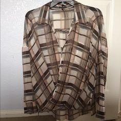 Vince Camuto spring 2015 blouse!! Only worn once, truly sad to let go!  Sheer blush, grey/blue, dark brown, taupe, pale grey and eggshell plaid pattern. Draped front with snap to secure, slight high low front to back. Front tulips while back hangs straight. Lovely piece!! Vince Camuto Tops Blouses