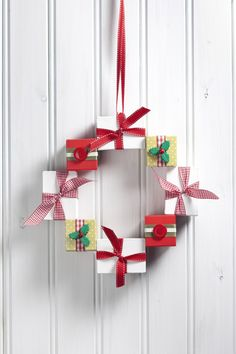 A Cute wreath made from painted favour boxes! 38 Totally Unique DIY Christmas wreaths #ChristmasCraft #Wreath