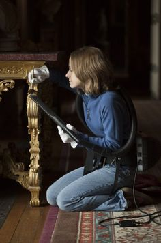 Sue cleaning at Peworth house.  No uniforms now.  She is mostly likely a volunteer as the house belongs to the National Trust UK.. Folk give their time and money to keep Englands Historical houses and parks safe for future generations... Bravo..