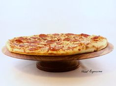 """Wooden Pedestal Pizza Stand/ Cake Stand from etsy.com $119    This 15"""" wide and 3 1/4"""" tall stand is hand turned on a wood lathe, from one piece of wood, no glue or screws. Finished with orange oil, waxed and buffed. Is food safe."""