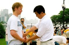 Learning the exercises: The founder of Falun Dafa, Mr. Li Hongzhi, correcting exercise movements of a student in Chicago. Though Falun Gong may seem exotic to those unfamiliar with Eastern traditions, its values are universal.  Since its introduction in 1992, Falun Dafa has been embraced by peoples in over 75 countries worldwide, and its central text, Zhuan Falun, has been translated into over 30 languages.