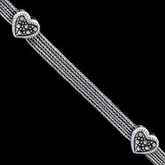 Silver necklace, marcasite, hearts Silver necklace, Ag 925/1000 - sterling silver. Three chains connected with a delicate heart design. Set with marcasite. Blackened silver. A wonderful, striking chain. Classic box closure (not lobster claw) with safety clatch. Dimensions approx. 9x4mm.