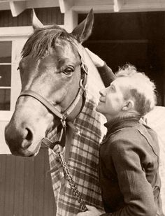 Seabiscuit and his rider, Red Pollard. One of my favorite photos ever.